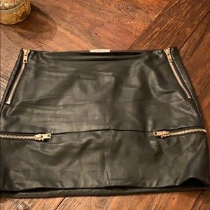 Edgy and fun leather look miniskirt with zippers!
